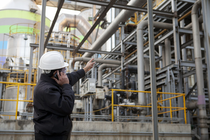 oil gas engineer pointing against pipeline